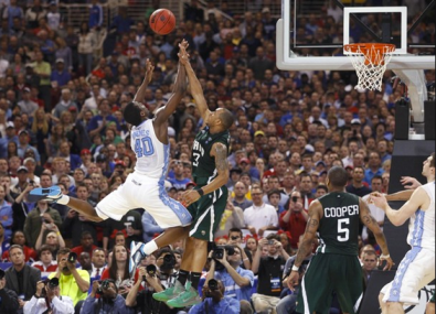 Ohio Bobcats guard Walter Offutt (3) blocks North Carolina Tar Heels forward Harrison Barnes (40) to send the game into overtime in Friday's Midwest Region game in St. Louis. North Carolina prevails in overtime, 73-65.Jeff Haynes / REUTERS