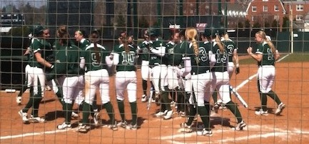 The Ohio University softball team celebrates during a double header against Canisius in March.
