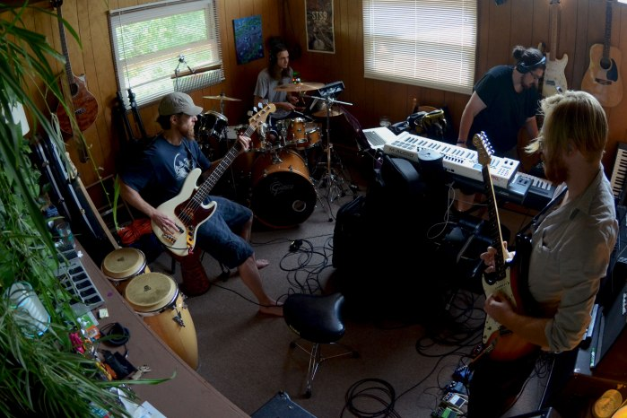 Rock Ban Manitoa rehearses their songs for the upcoming Werk Out Festival. From Left: Bassist Ed Q, Drummer DJ Reber, Keyboardist and Composer Collin Lesko, Guitarist Eric Turner. CREDIT: Evan Chwalek