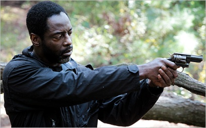 Isaiah Washington looks down the barrel of the small revolver. Photo by EW.