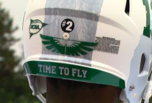 "All Eastern Michigan players wore a ""#2"" decal in memoriam of slain wide receiver Demarius Reed. (Scripps Media)"