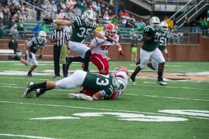 Ty Branz (#73) and Nathan Carpenter (#35) having been leading a defensive surge for Ohio. (Carl Fonticella)