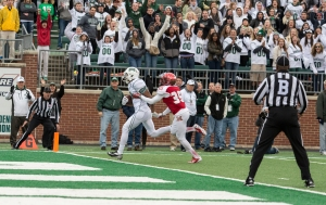 Donte Foster scores one of his three touchdowns Saturday vs. Miami (Carl Fonticella)