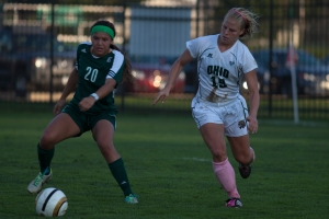 Martha Stevens controls the ball for Eastern Michigan as defender Gabby Hausfeld chases. (Nicholas Horsley)