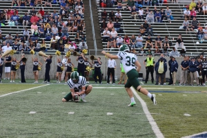Josiah Yazdani converts on his second of two field goals against Akron. (Zak Kolesar)