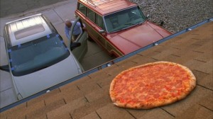 Walt takes a perfectly good pizza, and in a moment of anger throws it on the roof. Poor roof pizza.