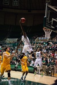 Maurice Ndour slams home two of his 23 points early in the first half. (Carl Fonticella)