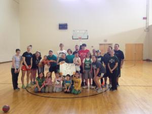 The participants and volunteers at a Hoops of Joy basketball clinic. Photo by Tony Moos.