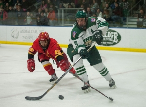 Mike LeFrenier protects the puck against Iowa State. (Carl Fonticella)
