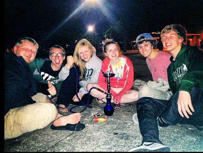 Left to right: Derek Whitaker,  Trevor Muir, Kelsie Malloy, Cecelia Ellis, Matt Webber and Dylan Cravens during one of their beloved hookah sessions. Photo courtesy of Trevor Muir.