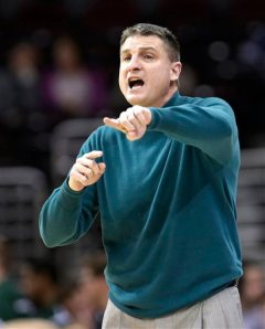 Jim Christian upgraded from the sweater on Thursday night, but he took off a flashy navy blazer before tip-off. (photo: bigstory.ap.org)