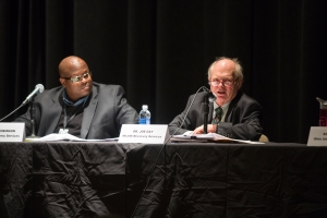 Reggie Robinson (left) and Dr. Joe Gay (right) during Tuesday night's debate. Dr. Gay is giving one of his rebuttals against the legalization of marijuana. Photo by Nick Horsley.