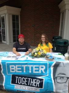 Phil Morehead and Olivia Bullock sit outside of Baker Center to promote Better Together. Photo by Krista Mobley.