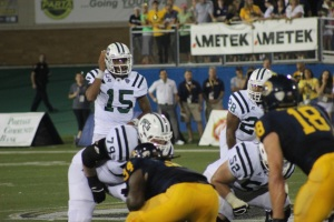 Ohio quarterback Derrius Vick calls a play for the offense. Ohio opened the season with a 17-14 victory at Kent State. Photo by Zak Kolesar.