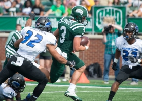 Ohio quarterback J.D. Sprague runs with the ball on Saturday afternoon. Ohio defeated Eastern Illinois, 34-19. Photo by Carl Fonticella.