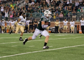 Ohio's Quentin Poling runs with the ball on Saturday night. Ohio defeated Idaho, 36-24. Photo by Carl Fonticella.