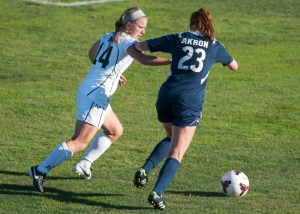 Ohio defender Mollie Whitacre (14) looks to stop Akron's attack. Photo by Carl Fonticella.