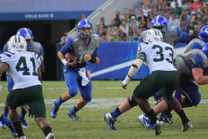 Kentucky quarterback Patrick Towles looks for room to run against Ohio on Saturday. Ohio lost its first game of the season, 20-3. Photo by Zak Kolesar.