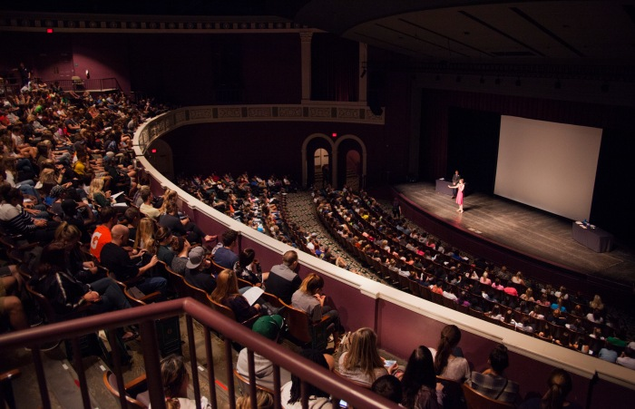 A packed auditorium listens as Dorian Solot and Connor Timmons discuss sex and female orgasms.