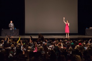 "Dorian Solot takes an audience poll during ""The Big O"" presentation at Memorial Auditorium on Sept. 18. Photo by Lauren Prescott."