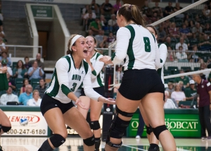 Abby Gilleland (No. 3) celebrates winning a point with Ali Lake. Ohio defeated Virginia Tech in four sets on Saturday. Photo by Carl Fonticella.