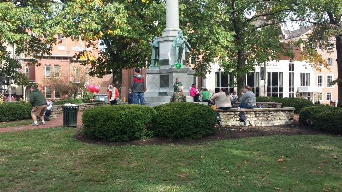 Following the homecoming parade, alumni gathered around the Civil War Monument to spend time with their families and other alumni.