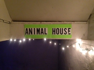 A throwback to the original Animal House adorns the stairwell into Butarsky's basement.