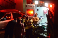 Muscle suits don't stop real injuries. A Halloween Block Party attendee is loaded into an ambulance.