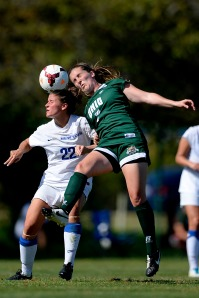 Ohio midfielder Erin Feeney goes up for header against Buffalo on Sunday. Photo by Calvin Mattheis.