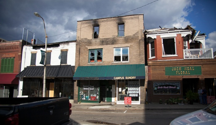 The building that housed apartments the Smoke Zone Smoke Shop was severely damaged during the Union Street fire on Sunday, Nov. 16.