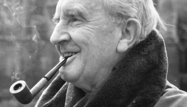 J.R.R. Tolkien, smoking a pipe just like the hobbits he so often wrote about. Photo from Guardian.