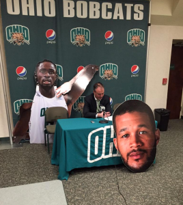 Saul Phillips carried cutouts of Willis and Ndour to his postgame presser. | Twitter, @ohiobobcattv