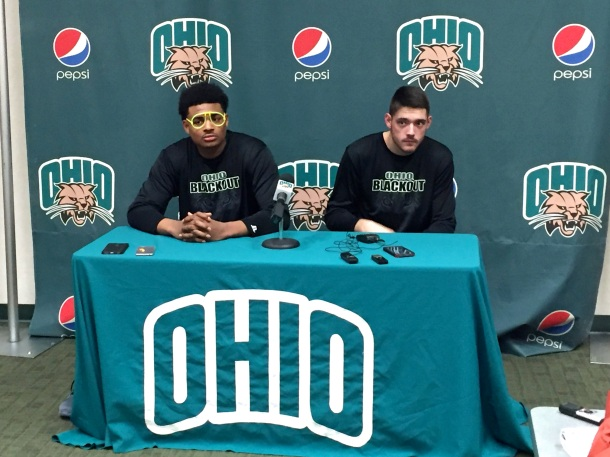 Tony Campbell (left) dons glow stick glasses in the postgame press conference after his 28 points led Ohio to victory over Kent State.  (Photo by Corbin Bagford)